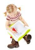 Desenho pré-escolar da menina em uma placa Fotografia de Stock Royalty Free