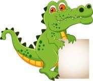 Desenhos animados do crocodilo com sinal em branco Imagens de Stock Royalty Free