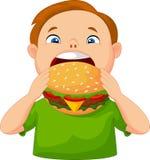 Desenhos animados do menino que comem o hamburguer Fotos de Stock