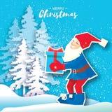 Desenhos animados do Natal de Santa Claus que guardam uma caixa de presente com curva Cartão do Feliz Natal do corte do papel inv Imagens de Stock Royalty Free