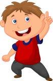 Desenhos animados do rapaz pequeno que apontam com o dedo Foto de Stock