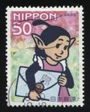 Desenhos animados japoneses com uma letra Imagens de Stock