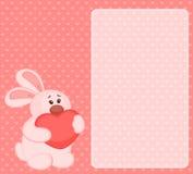 Desenhos animados pouco coelho do brinquedo com coração Fotos de Stock Royalty Free