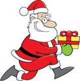 Desenhos animados Santa Claus com um presente Fotos de Stock Royalty Free