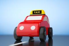 Desenhos animados Toy Car com sinal do táxi Foto de Stock Royalty Free
