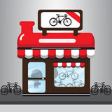 Desenhos animados vermelhos da loja da bicicleta Fotografia de Stock