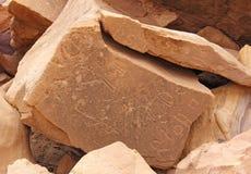 Desenhos antigos cinzelados na pedra Imagem de Stock Royalty Free