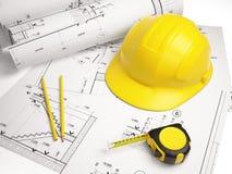 Desenhos arquitetónicos com ferramentas da construção Fotos de Stock