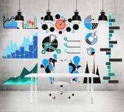 Desenhos com cartas e gráficos na parede Fotografia de Stock Royalty Free