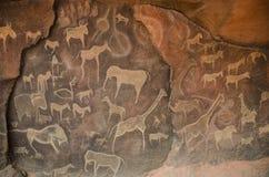 Desenhos da caverna do Petroglyph Fotos de Stock