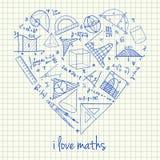 Desenhos das matemáticas na fôrma do coração Fotografia de Stock Royalty Free