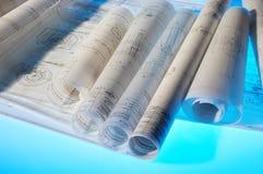 Desenhos de projeto Rolled-up Fotografia de Stock