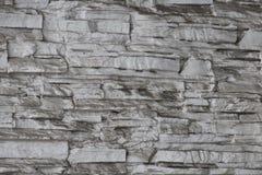 Deseniowy szary kolor nowożytnego stylowego projekta kamiennej ściany dekoracyjna nierówna krakingowa istna powierzchnia z cement zdjęcia royalty free
