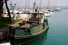 Desenzano del Garda. Small harbor with lighthouse and boats in Desenzano near lake Garda Stock Photography
