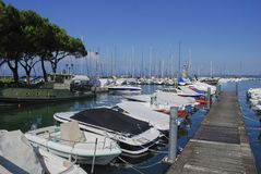 Desenzano del Garda, Italy, boats stand on the pier stock images