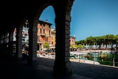 Venetian-style palaces overlooking a little harbour and a small square. Desenzano del Garda, Italy - July 23, 2018: Venetian-style palaces overlooking a little royalty free stock photo