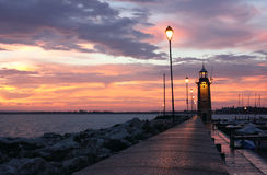 Desenzano del Garda Lighthouse. Amazing Sunrise at Desenzano del Garda with the marina and the old Lighthouse Stock Image
