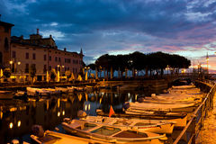 Desenzano Del Garda marina in the early morning. Desenzano Del Garda marina with fishing boats in early morning, just before dawn Stock Images
