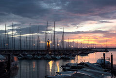 Desenzano del Garda Marina with the Old Lighthouse. Colorful sunrise at Desenzano del Garda with the Marina and the old lighthouse Royalty Free Stock Image