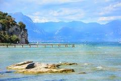 Desenzano garda lake pontoon. Desenzano del Garda town Italy lake and boats landscape Royalty Free Stock Photos