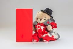 Deseo del oso de peluche usted Año Nuevo chino feliz Fotos de archivo libres de regalías