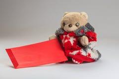 Deseo del oso de peluche usted Año Nuevo chino feliz Imágenes de archivo libres de regalías