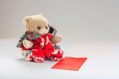 Deseo del oso de peluche usted Año Nuevo chino feliz Fotografía de archivo libre de regalías