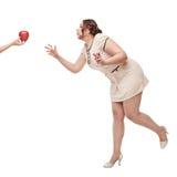 Deseo hermoso de la mujer del tamaño extra grande para la manzana Fotos de archivo