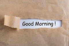 Deseos de la buena mañana en un sobre rasgado foto de archivo libre de regalías
