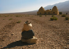 Desert. Ed landscape with stones and the house in traditional Arabian style Royalty Free Stock Images