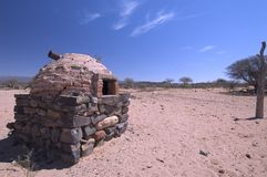 Desert. Ancient Oven built by Stones in a desertic landscape stock image