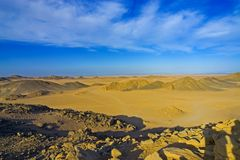 Desert 12. Desert, waves, golden sand and sky royalty free stock image