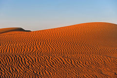 Desert. Sand dune with wind-made waves Royalty Free Stock Photos