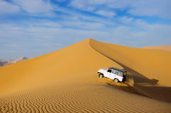 Desert. Driving a jeep in the badain jaran  desert china Stock Images