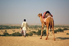 Desert. Man and camel in desert Royalty Free Stock Images