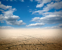Desert. With the dry earth and the blue sky Royalty Free Stock Photo