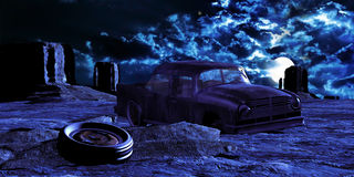 Desert abandoned car. A broken and abandoned car at night, in Monument Valley Royalty Free Stock Photos