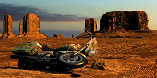 Desert abandonned motorcycle. A broken old motorcycle in Monument Valley Stock Photography
