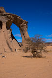 Desert acacus libia. Wind erosion, arch of rock in the sky Stock Image