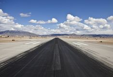 Desert Airport Jet Runway Skid Marks. Heavy skid marks on a busy North American desert airport runway Royalty Free Stock Images