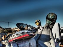 Desert Aliens Wearing Hoodies and Sunglasses. Two aliens wearing hooded sweatshirts and sunglasses in the Southern California desert near Jacumba stock photos