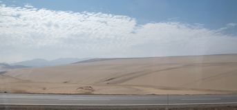 The Desert Along the Road Heading South in Peru. The dry desert along the road heading south from Lima, Peru stock photo