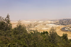 Desert area of West Bank and palestinian towns and villages behind the West Bank separation wall Stock Photo