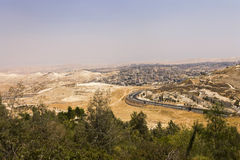 Desert area of West Bank and palestinian towns and villages behind the West Bank separation wall Stock Images