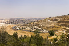 Desert area of West Bank and palestinian towns and villages behind the West Bank separation wall. In the background, Israel, Middle east. View from the East Royalty Free Stock Photo