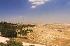 Desert area of West Bank and palestinian towns and villages behind the West Bank separation wall Stock Photos