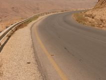 Desert asphalt highway. Verge of an asphalt road, stone desert highway, King's highway, Jordan, Middle East Stock Image