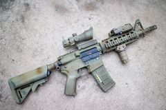Desert Assault rifle. M4A1 on the floor Royalty Free Stock Image