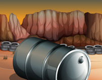 A desert with a barrel and tires Royalty Free Stock Image