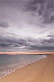 Desert beach. Under a stormy sky Stock Image